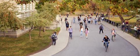 People walking down street on campus