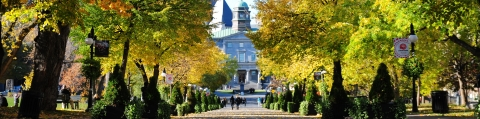 McGill's Arts Building with Autumn trees surrounding it