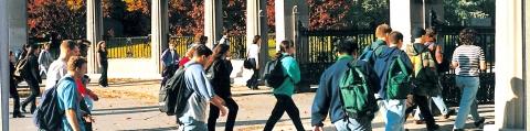 Students walking through the Roddick Gates