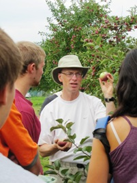 The instructor David Wees explains the directives for apple harvest