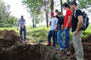 Third year students look at a field's drainage