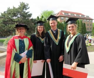 Caroline Begg with 2014 grads Tiffany Nelson, Brandon Arnold, Justine Pouliot