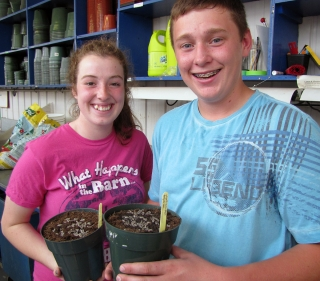 Ag Botany students showing their newly potted soybeans