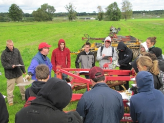 In the morning, the first group observes a chiesel plow.