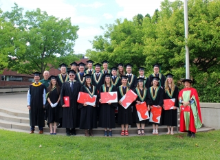 The FMT Class of 2018 stands outside at Macdonald Campus with staff members at Convocation in June 2018