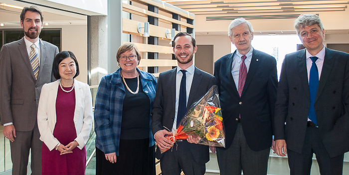 Lukas Vanhonnaeker surrounded by his supervisor and jury after a successful thesis defense.