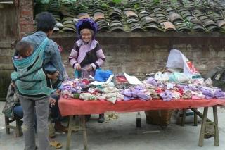 Hmong medicinal herb seller, Xiao Bazi border-market, Yunnan, China