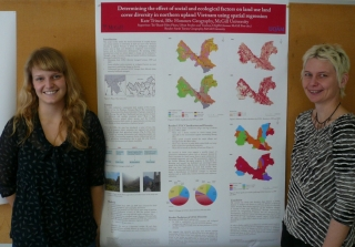 Honours student Kate Trincsi and Prof Sarah Turner with Kate's poster on LULCC i
