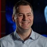 Dr. Tim Haltigin