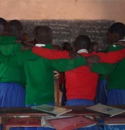 LMIC schoolchildren in uniform giving each other accolades