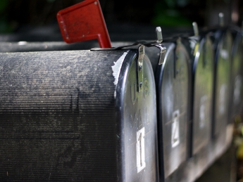 Close up of four aligned mailboxes
