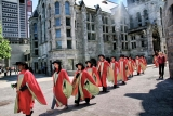 photo of Ph.D. students in scarlet gowns with pale green facings.