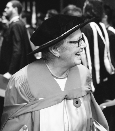 female faculty member on graduation day (in black-and-white)