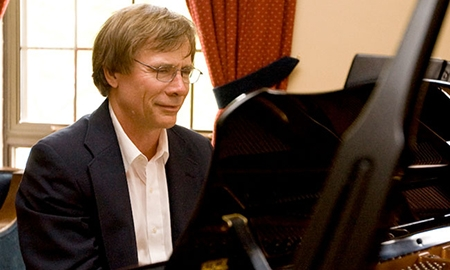 Graham Sommer playing the piano
