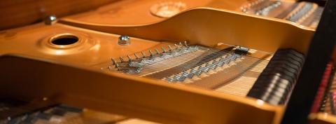 Close up photo of interior of piano