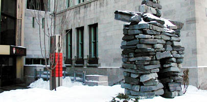 A winter view of the inukshuk gracing the entrance of the 688 Sherbrooke West building