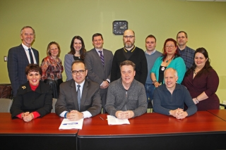 MUNACA's delegation was led by (first row, from right) David Roseman and Kevin Whittaker, while Michael Di Grappa and Lynne B. Gervais took part on McGill's behalf. / Photo: Neale McDevitt