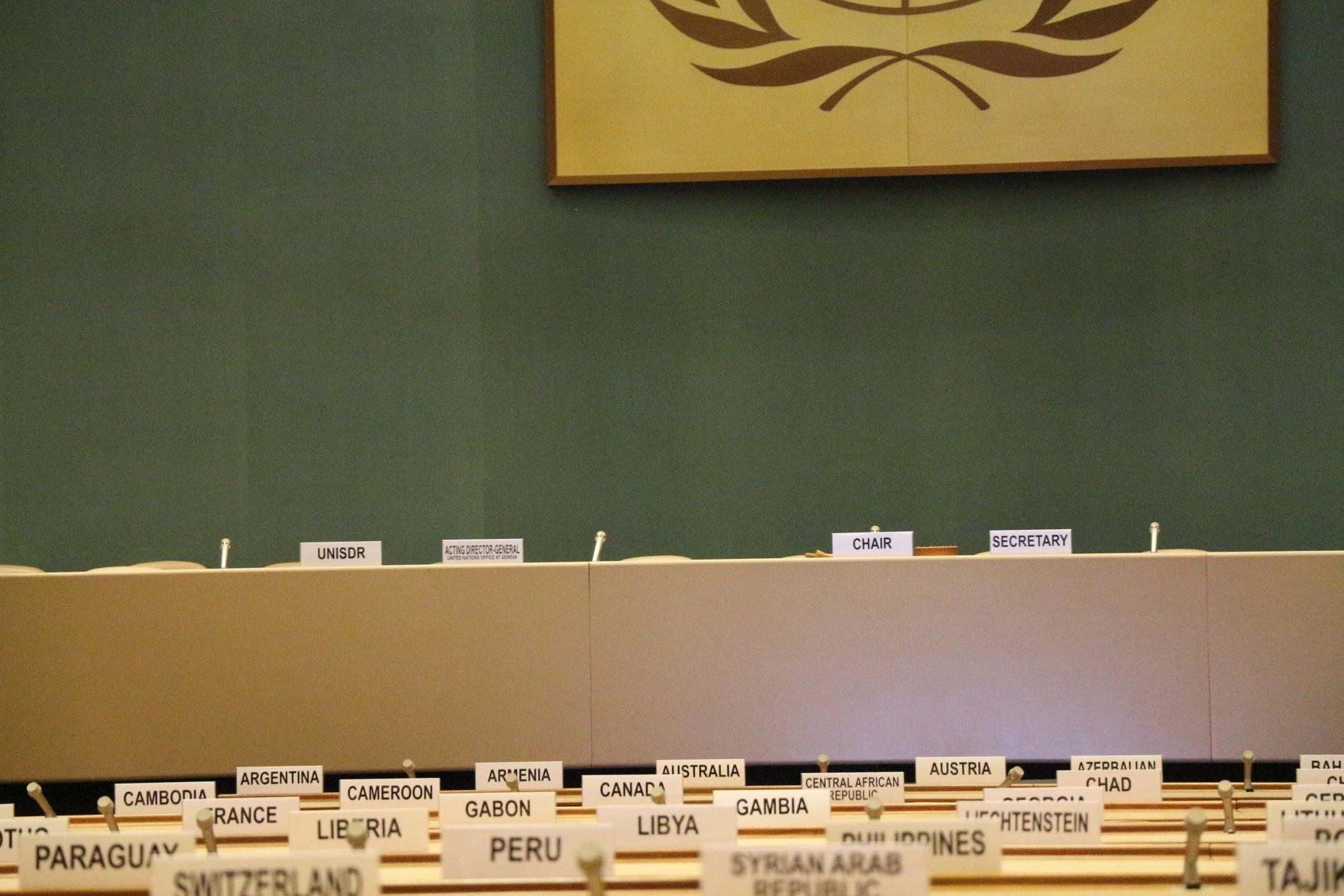 UN meeting room. Photo by Davi Mendes on Unsplash