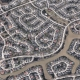 Arial view of tightly packed homes roads