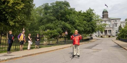 Michael Loft, former social work professor, speaks in front of the McGill arts building.