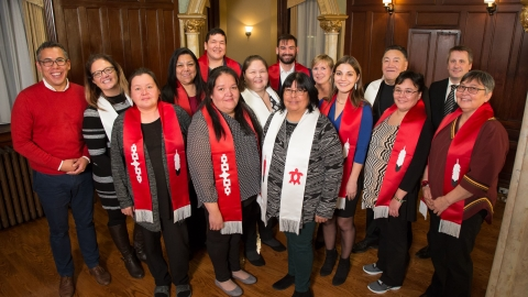Graduating students with red sashes at the First Peoples' House