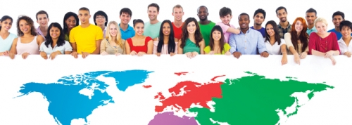 Students of different nationalities holding a big multi-coloured map of the world