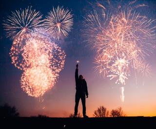 A person enjoying a fireworks display