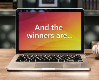 "Laptop displaying the text ""And the winners are..."""