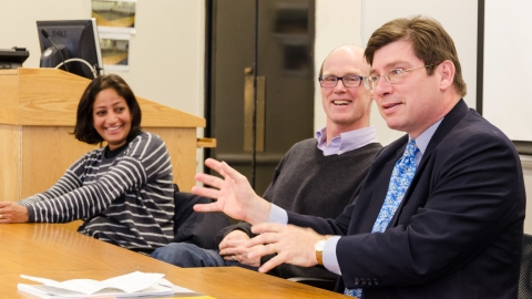 Faculty members in conversation