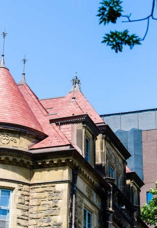 The red slate peaked roof of Old Chancellor Day Hall on a sunny day. Photo by Lysanne Larose.