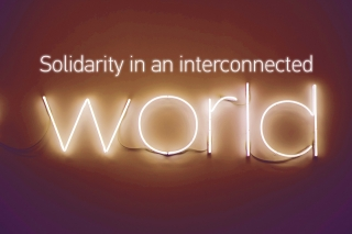 'Solidarity in an interconnected world.' Image based on a photo by 2Photo Pots @2photopots on Unsplash.