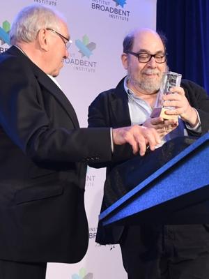Ed Broadbent handing Daniel Weinstock the Charles Taylor Prize.