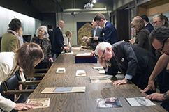 people viewing materials from the Archives