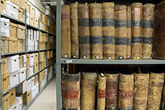 Shelves in Archives with old bound volumes