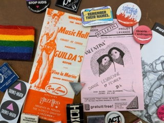 Various pamphlets, pins and paraphernalia relating LGBT+ culture.
