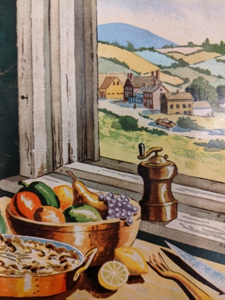 Table set with summer food in front of an open window.