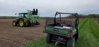 two tractors in a farm field
