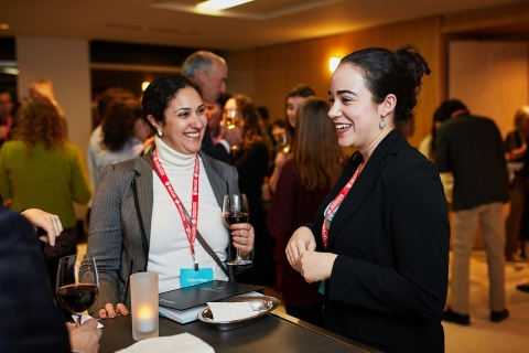 Two people sharing a laugh at an event