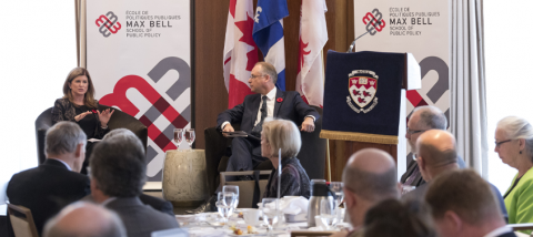 A 2017 Max Bell School event with two people on stage surrounded by seated guests