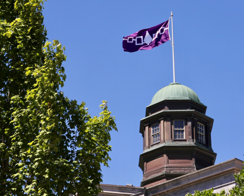 McGill Arts building cupola flying Indigenous peoples flag at full mast