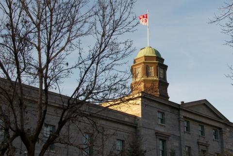 McGill Arts building cupola with McGill University flag at full mast