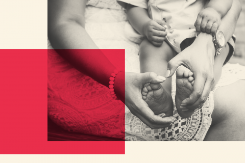 Picture of a person holding a child's feet with red square overlay