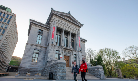Two students walk past a McGill University building