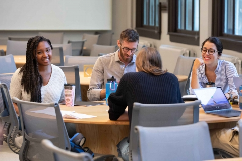 Students having discussion around table