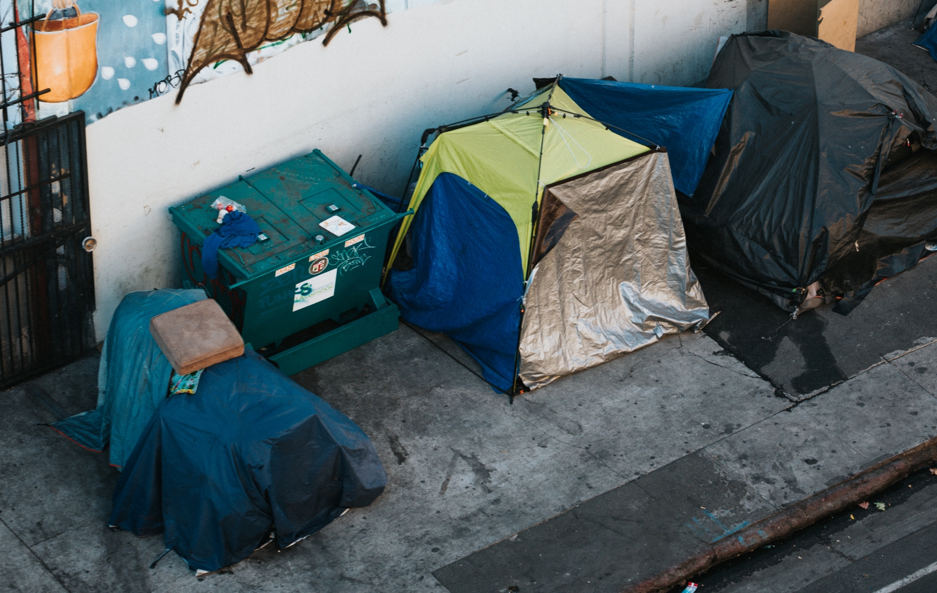 An urban encampment of tents for unhoused people