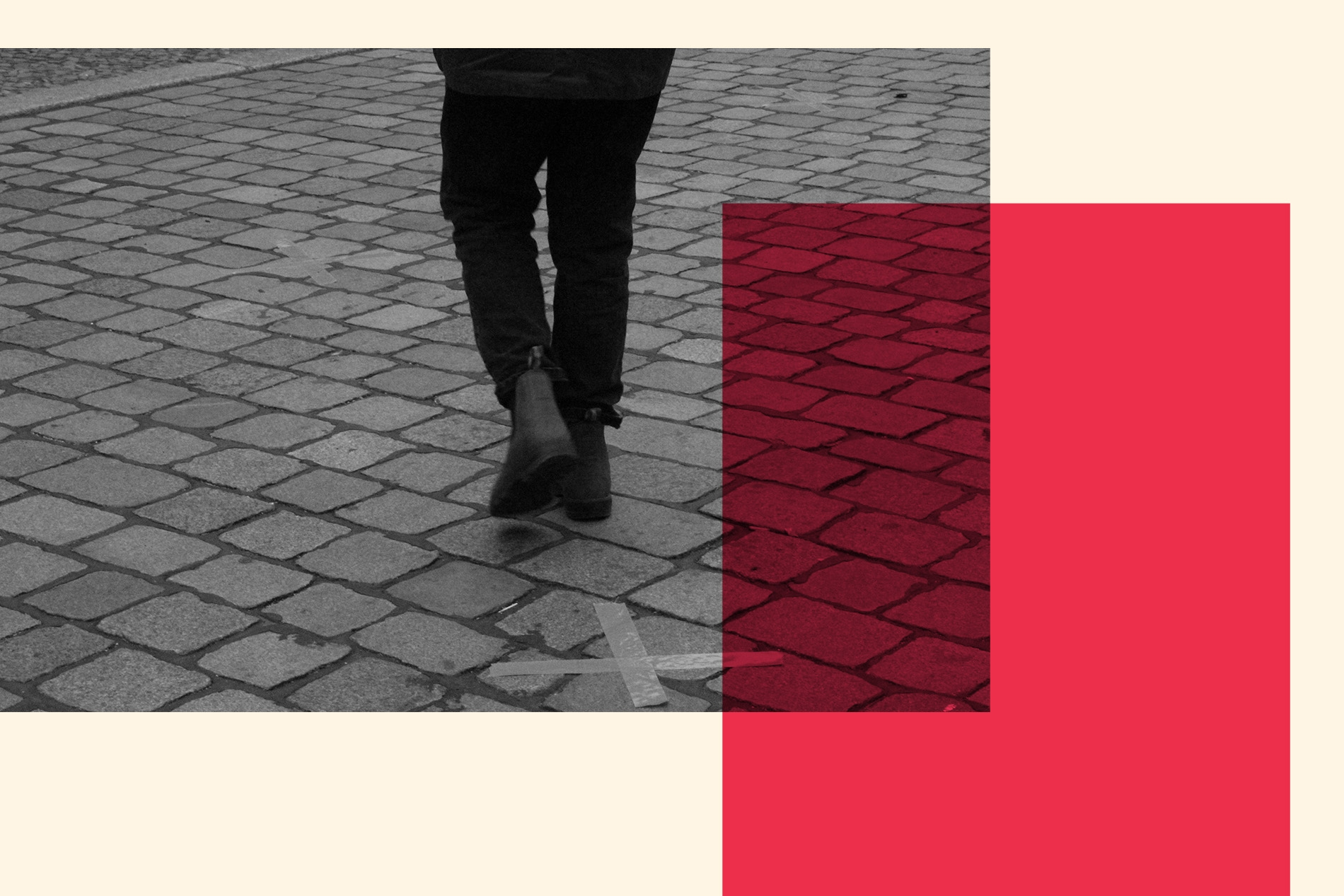 A person walks by a social-distancing marker on a street