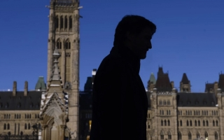 Prime Minister Justin Trudeau makes his way back to his office after holding a press conference