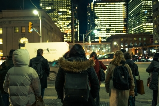 Pedestrians walk outside Union Station in downtown Toronto a cold winter night