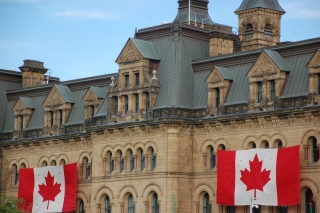 Canadian flags hung on a government building