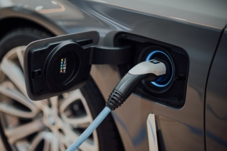 A photograph of an electric vehicle being charged